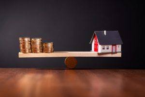 Weighing money VS. a home