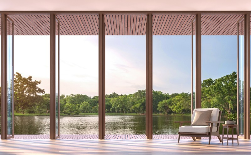 Lake Side View From A Living Room With Wooden Floors